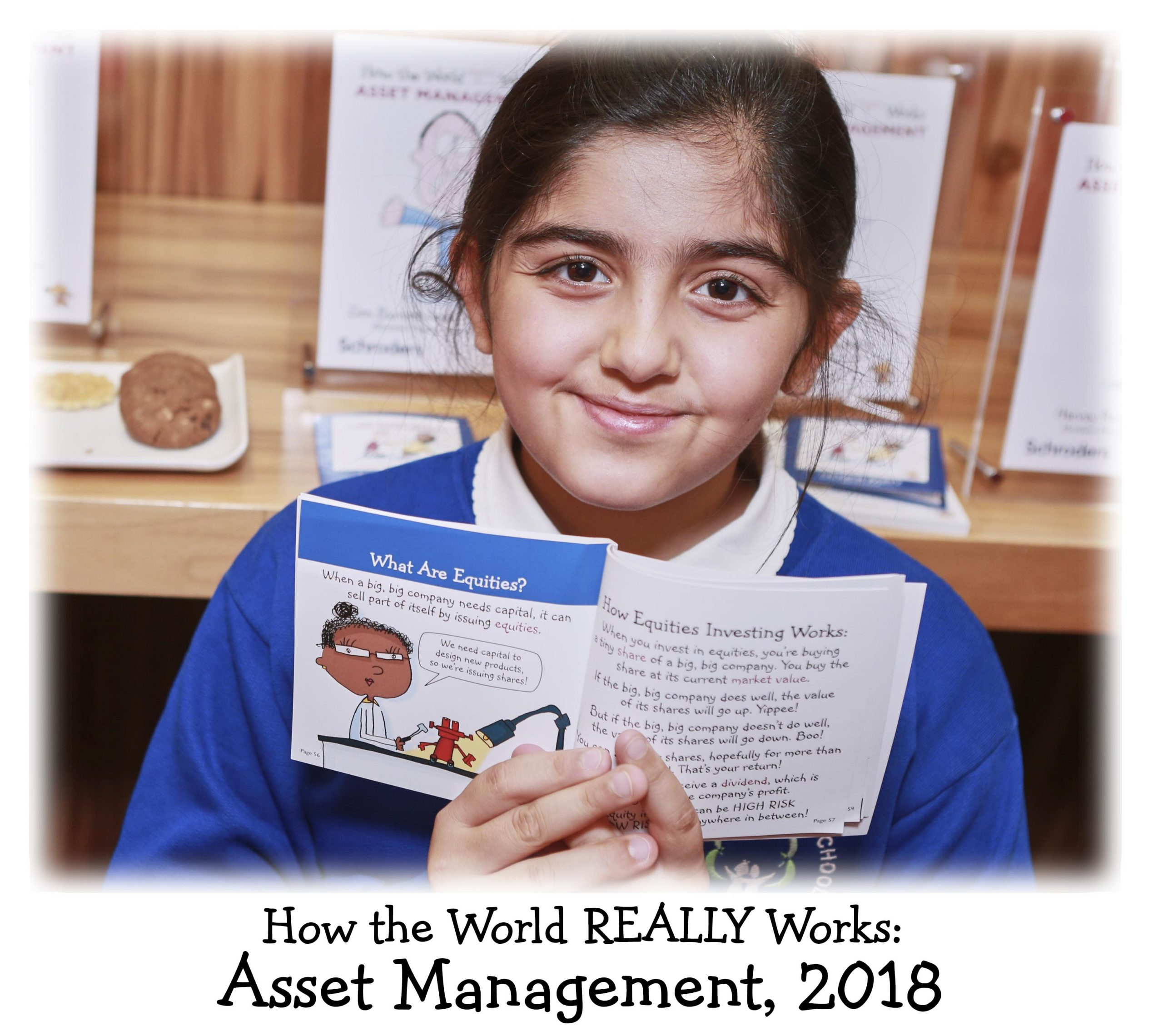 A child shows her drawing in the Asset Management book