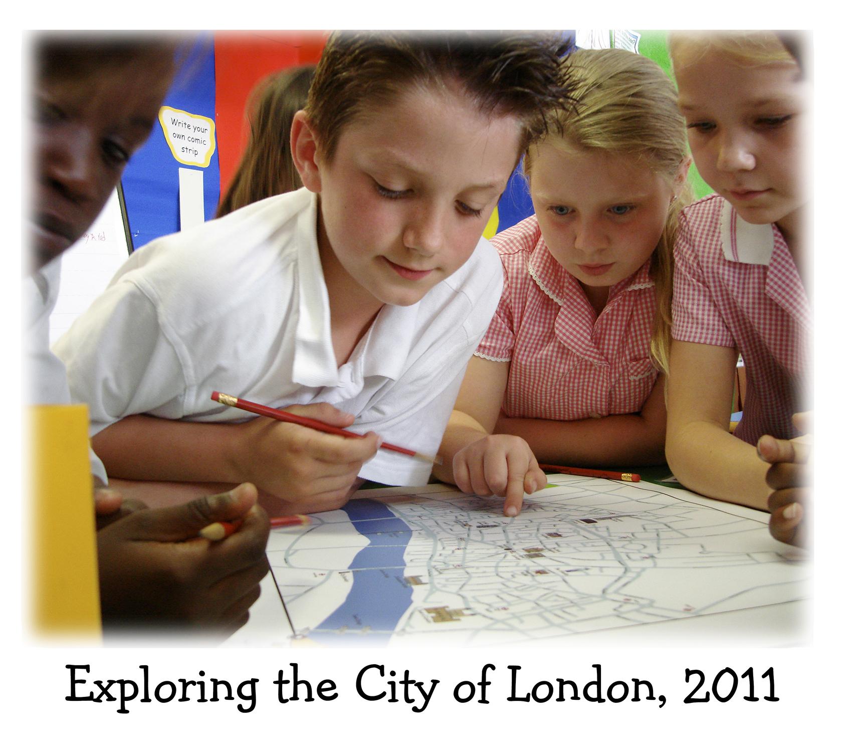 Four children examine a map in a Guy Fox workshop